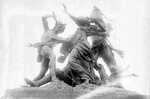"""This statue, originally called the Fort Dearborn Massacre, was placed on the site of the battle by property owner George Pullman about the year 1893. The bronze work by Carl Rohl-Smith fell into disrepair. In 1931 it was acquired by the Chicago Historical Society. The statue was moved to the lobby of the museum. In 1972 the subtitle """"The Potawatomi Rescue"""" was added to the monument. It was returned to Prairie Avenue in the 1980's, according to historian John Schmidt. It was removed from the Clarke House grounds in 1997, being put in storage. The statue and the subject of the American relations with native nations remains a politically sensitive subject. Credit: Library of Congress/ Chicago Daily News with the closeup provided by WBEZ."""
